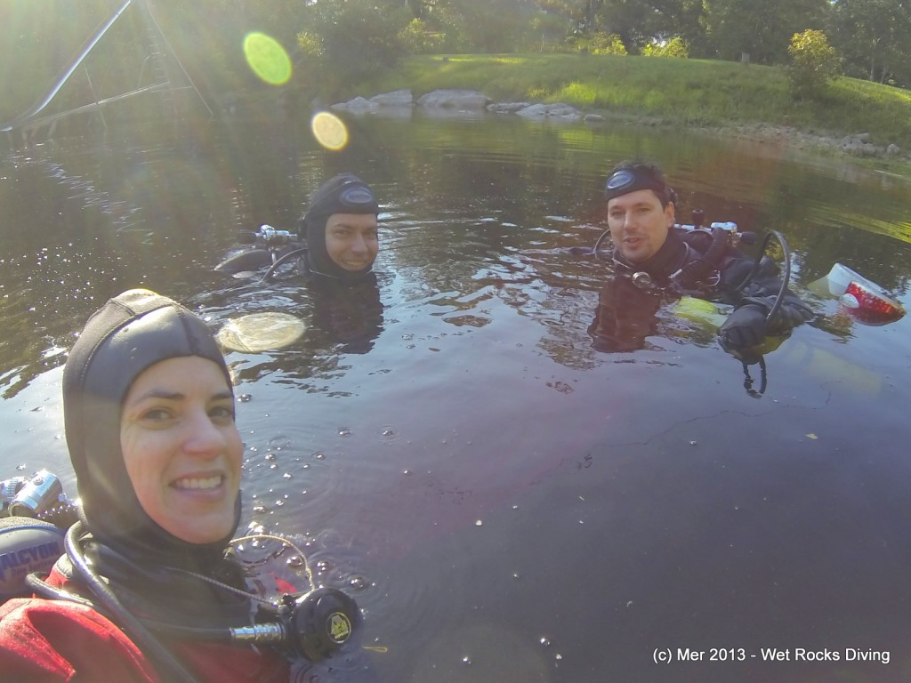 """Mer, PZ, and Grif in the Indian Springs basin with one of """"our little (gator) friends"""" in the background"""